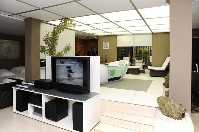 Loft Hi-tech da iHouse: sistema de DVD e som incorporado à automação do imóvel | Lourenço Manfredini/Divulgação