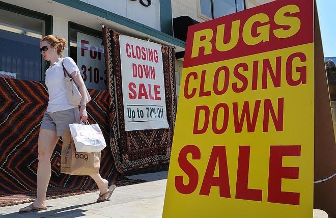 Comércio nos EUA:  para OCDE, aumento  do desemprego vai desacelerar | Mark Ralston/AF