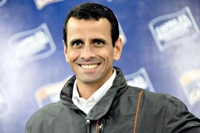 Capriles, opositor de Chávez, terá a ajuda de Renato Pereira | Leo Ramirez/AFP