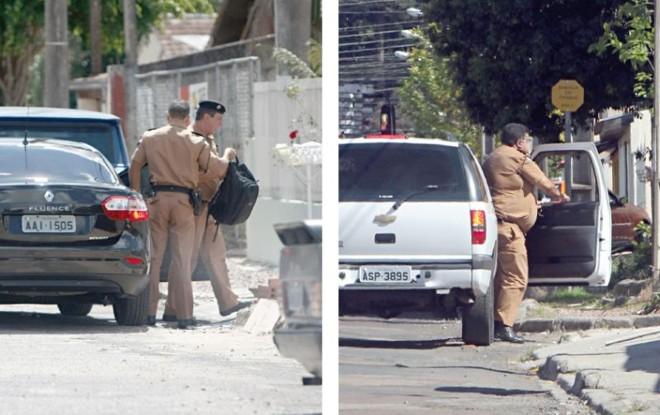 Subcomandante da PM  e o coronel responsável pelo 1.º Comando Regional chegam em casa   Fotos: Albari Rosa/Gazeta do Povo