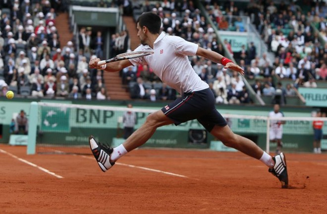 Novak Djokovic conseguiu salvar quatro match points diante de Jo-Wilfried Tsonga e venceu a partida | AFP