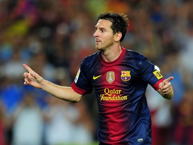 Jogador argentino Lionel Messi comemora após gol marcado em jogo contra o Real Madrid | AFP PHOTO/ LLUIS GENE