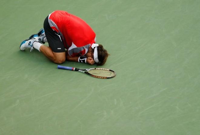 Emocionado, David Ferrer comemora a classificação para as semifinais do US Open | Mike Stobe / AFP
