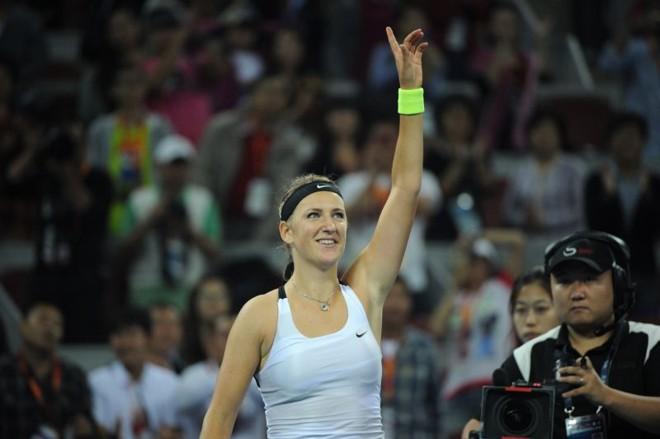 A tenista Victoria Azarenka, da Bielorússia enfrenta Maria Sharapova na final de Pequim | AFP PHOTO/ Ed Jones