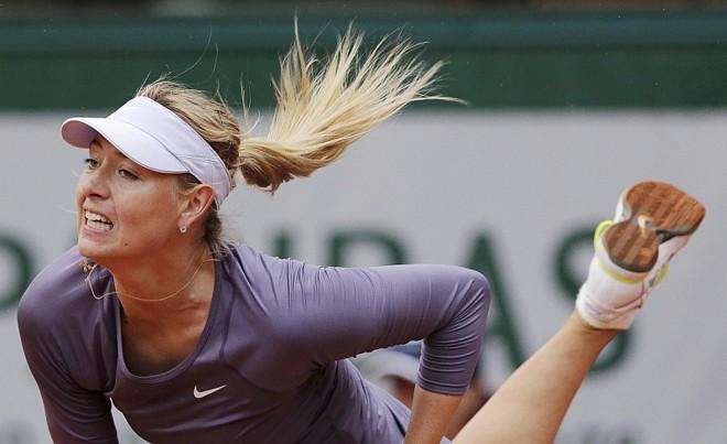 Sharapova teve de esperar duas interrupções acabarem para vencer e ir à 3ª Rodada de Roland Garros | Philippe Wojazer / Reuters