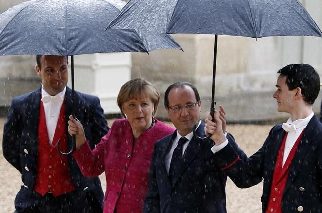 Angela Merkel e  Hollande se encontraram em Paris | Charles Platiau/Reuters