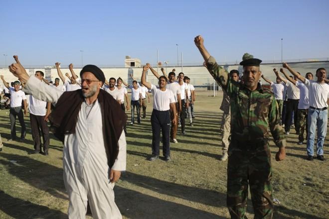 Apesar das derrotas do governo, voluntários xiitas se apresentam para ingressar nas Forças Armadas iraquianas | Ahmad Mousa/Reuters