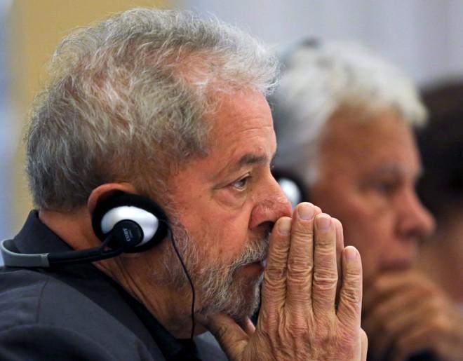 Lula durante seminário com o ex-presidente do Governo da Espanha, Felipe González (ao fundo). | Paulo Whitaker/Reuters