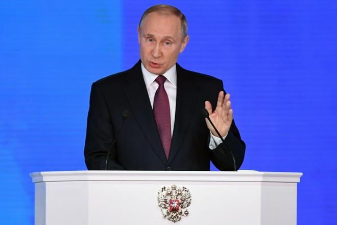 O presidente russo Vladimir Putin dirige-se à Assembléia Federal no centro de exposições Manezh, em Moscou | YURI KADOBNOV/AFP