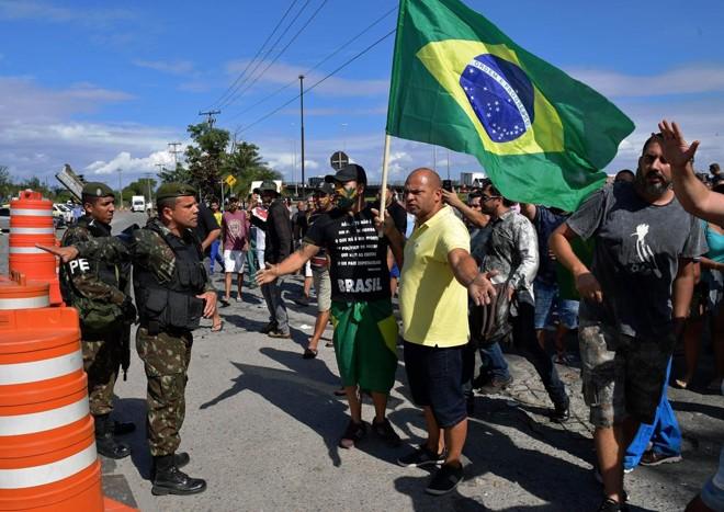 | Carl de Souza/AFP