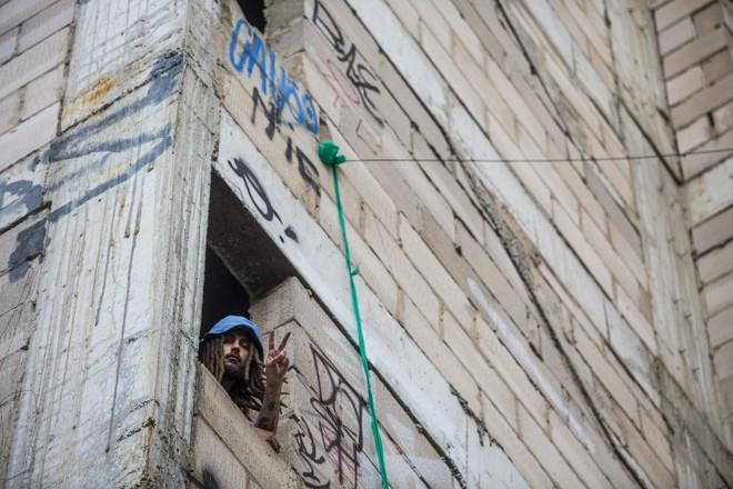 Ocupação de prédio abandonado:proposta de Haddad é aproveitar imóveis públicos sem uso para habitação. | Brunno Covello/Gazeta do Povo