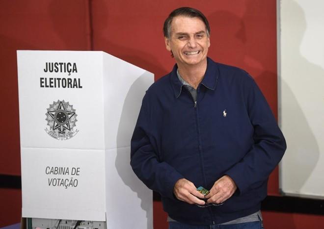Até meados de abril Jair Bolsonaro terá de deixar claro para o cidadão e para o setor produtivo e financeiro o que pretende fazer em seu governo. | Mauro Pimentel/AFP