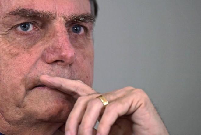 Presidente eleito, Jair Bolsonaro diz que não deve mais realizar a fusão entre as pastas do Ministério da Agricultura e do Meio Ambiente. | CARL DE SOUZA/AFP