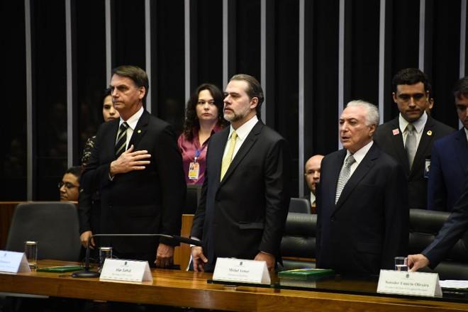 Bolsonaro  participou de sessão solene no Congresso, nesta terça-feira (6), ao lado de Dias Toffoli e Michel Temer   Evaristo SA/AFP