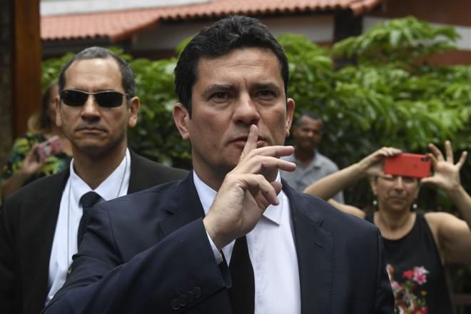 Juiz Federal Sergio Moro: antes de aceitar ser ministro da Justiça, rotina incluiu interrogatório de Eduardo Cunha e pedido de ação contra Mantega. | MAURO PIMENTEL/AFP