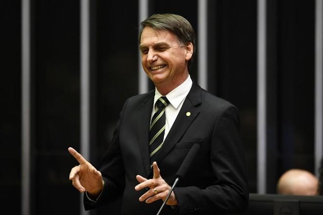 Jair Bolsonaro participou de cerimônia alusiva aos 30 anos da aprovação da Constituição Federal, nesta terça-feira, no plenário do Congresso. | Evaristo Sa/AFP