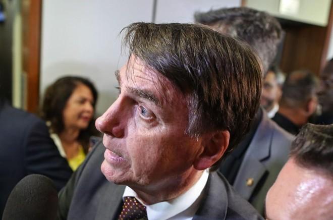 O presidente eleito Jair Bolsonaro visitou o TSE nesta terça-feira. | Sergio Lima/AFP