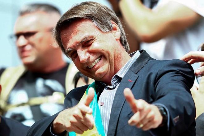 O presidente eleito definiu quem são os 22 ministros do seu governo. Agora o foco é no segundo escalão, no qual Bolsonaro aceitará sugestões de partidos.   Heuler Andrey/AFP