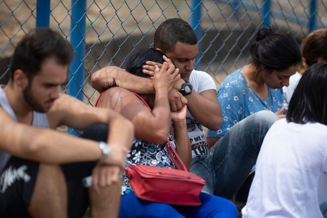 Parentes e amigos reclamam de falta de informação sobre pessoas ainda desaparecidas em Brumadinho | Mauro Pimentel/AFP