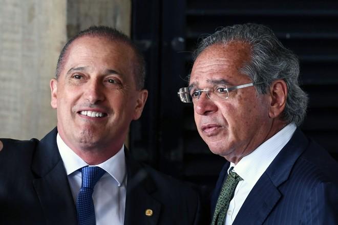 Onyx Lorenzoni e Paulo Guedes: disputa no novo governo. | EVARISTO SA/AFP
