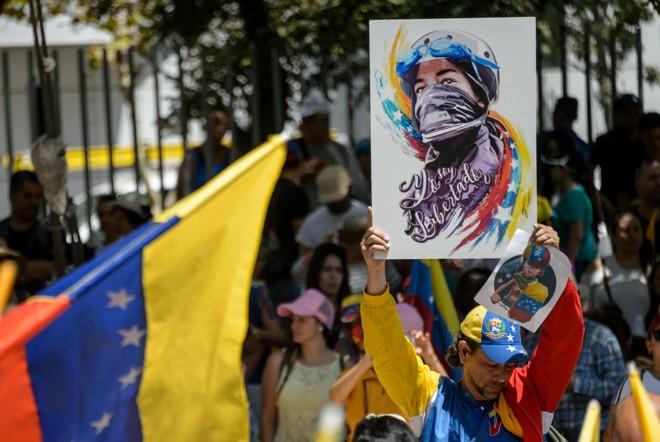 Opositores de Maduro participam de protesto em Caracas. | Martin Bernetti/AFP