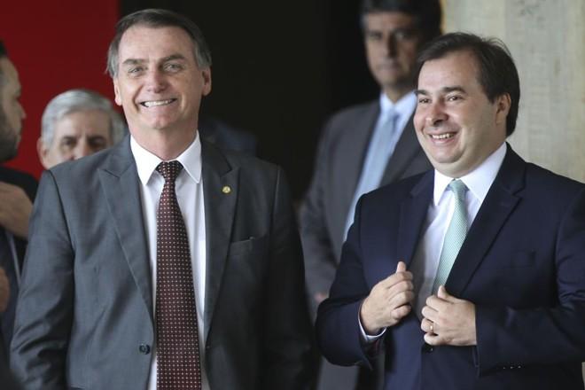 O presidente Jair Bolsonaro com Rodrigo Maia (DEM). | Antonio Cruz/Agência Brasil