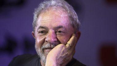 Luiz Inácio Lula da Silva sorri. Foto: Miguel Schincariol/AFP.