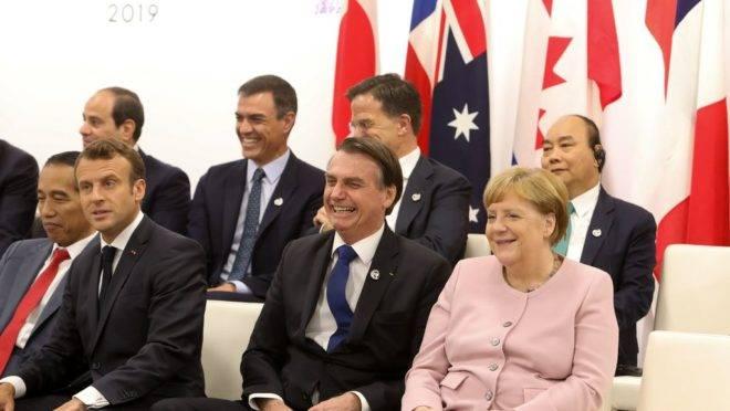 Presidente da República, Jair Bolsonaro, durante reunião paralela dos Líderes do G20, em Osaka, Japão.