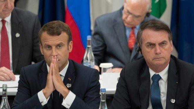 O presidente francês Emmanuel Macron e Jair Bolsonaro, durante o G-20 em Osaka, no Japão.