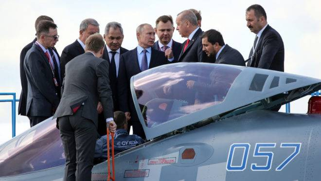Vladimir Putin and Recep Tayyip Erdogan inspect a Sukhoi Su-57 fighter jet in Moscow, on Aug. 27, 2019. MUST CREDIT: Bloomberg photo by Andrey Rudakov.