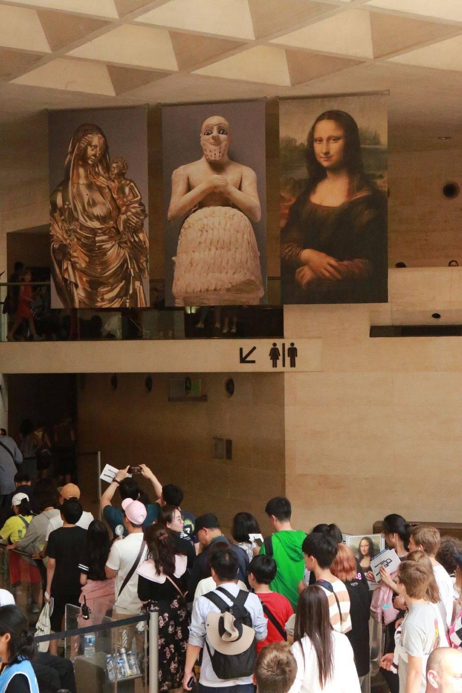 Após passarem pelos detectores de metais, os portadores dos ingressos são organizados como ovelhas em uma longa fila. Foto: Owen Franken/The New York Times.