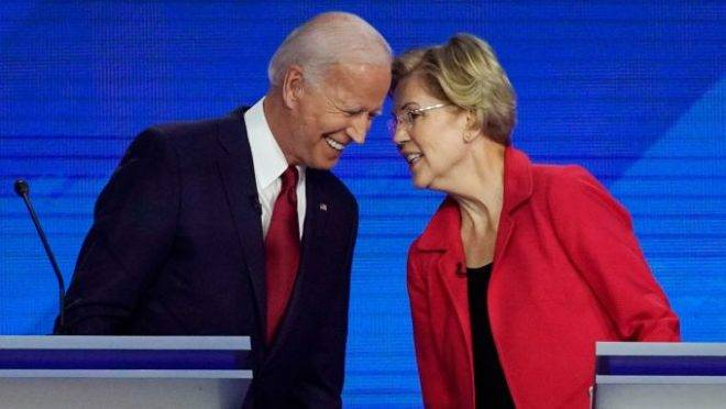 Mandatory Credit: Photo by David J Phillip/AP/Shutterstock (10412432o) Democratic presidential candidates former Vice President Joe Biden, left and Sen. Elizabeth Warren, D-Mass., talk, during a Democratic presidential primary debate hosted by ABC at Texas Southern University in Houston Election 2020 Debate, Houston, USA – 12 Sep 2019