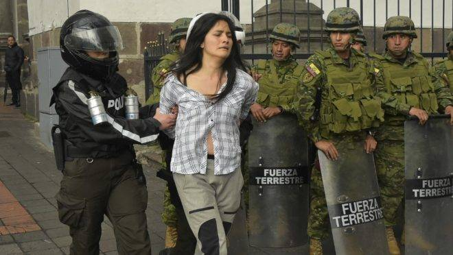 A demonstrator is detained during clashes which erupted during a transport strike against the economic policies of the government of Ecuadorean President Lenin Moreno regarding the agreement signed on March with the International Monetary Fund (IMF), on October 3, 2019. – The Ecuadorean government confirmed possible labour and tax reforms as established in the agreement, Economy Minister Richard Martinez stated -a day after announcing the elimination of fuel subsidies. (Photo by Rodrigo BUENDIA / AFP)