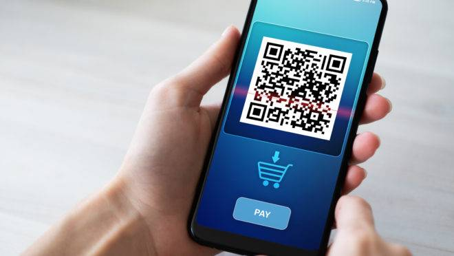 QR code mobile phone scan on screen. Business and technology concept.