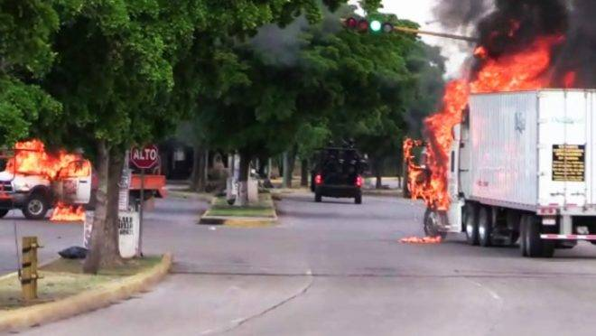 "In this AFPTV screen trucks burn in a street of Culiacan, capital of jailed kingpin Joaquin ""El Chapo"" Guzman's home state of Sinaloa, on October 17, 2019. – Heavily armed gunmen in four-by-four trucks fought an intense battle against Mexican security forces Thursday in the city of Culiacan, capital of jailed kingpin Joaquin ""El Chapo"" Guzman's home state of Sinaloa. (Photo by STR / AFP)"