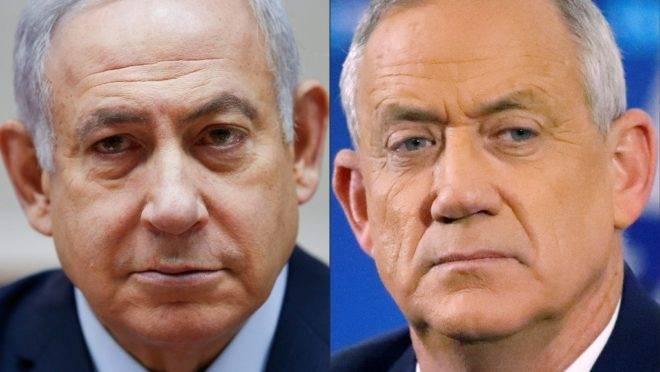 O primeiro-ministro de Israel, Benjamin Netanyahu (esq), e o líder do partido Azul e Branco, Benny Gantz