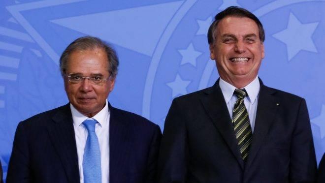 O ministro Guedes e o presidente Bolsonaro no lançamento do programa Verde Amarelo.