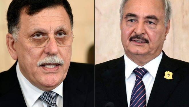 Rivais líbios Fayez al-Sarraj e Kalifa Haftar
