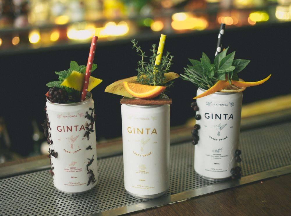 A gim tônica enlatada Ginta terá mais dois sabores além do clássico de limão siciliano com tangerina e laranja. Foto: divulgação.
