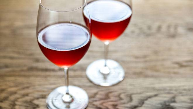 Glasses Of Rose Wine On The Wooden Table