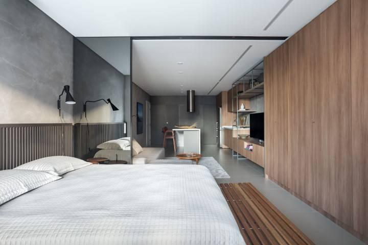 Cozinha, sala de estar e quarto em espaço único, porém delimitado. Foto: Eduardo Macarios