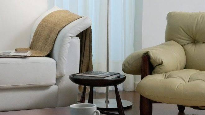 Apartamento no Cabral, em Curitiba, foi reformado por Ivan Wodzinski para receber uma família com um filho jovem, valorizando mobiliários brasileiros assinados e objetos de decoração de família.