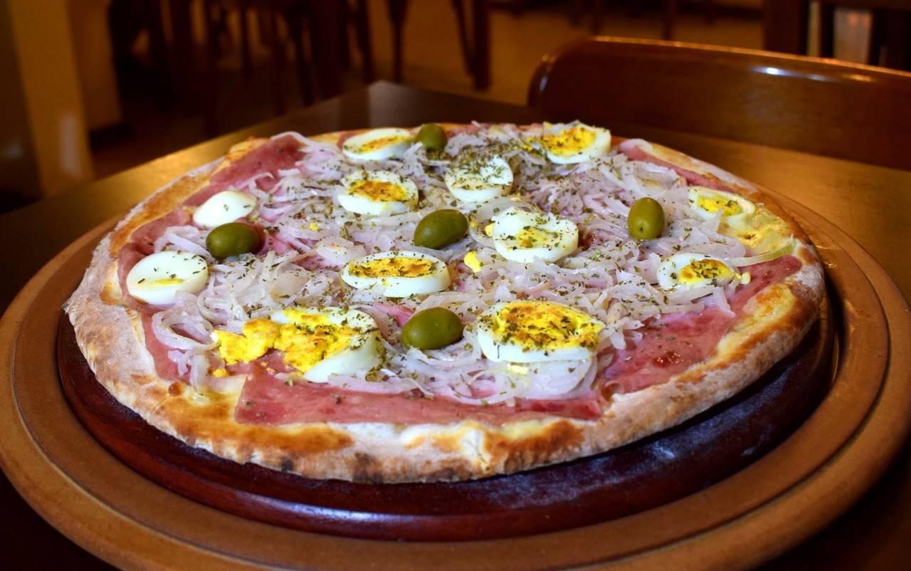 Pizza portuguesa de O Rei da Pizza. Foto: Divulgação/Vina