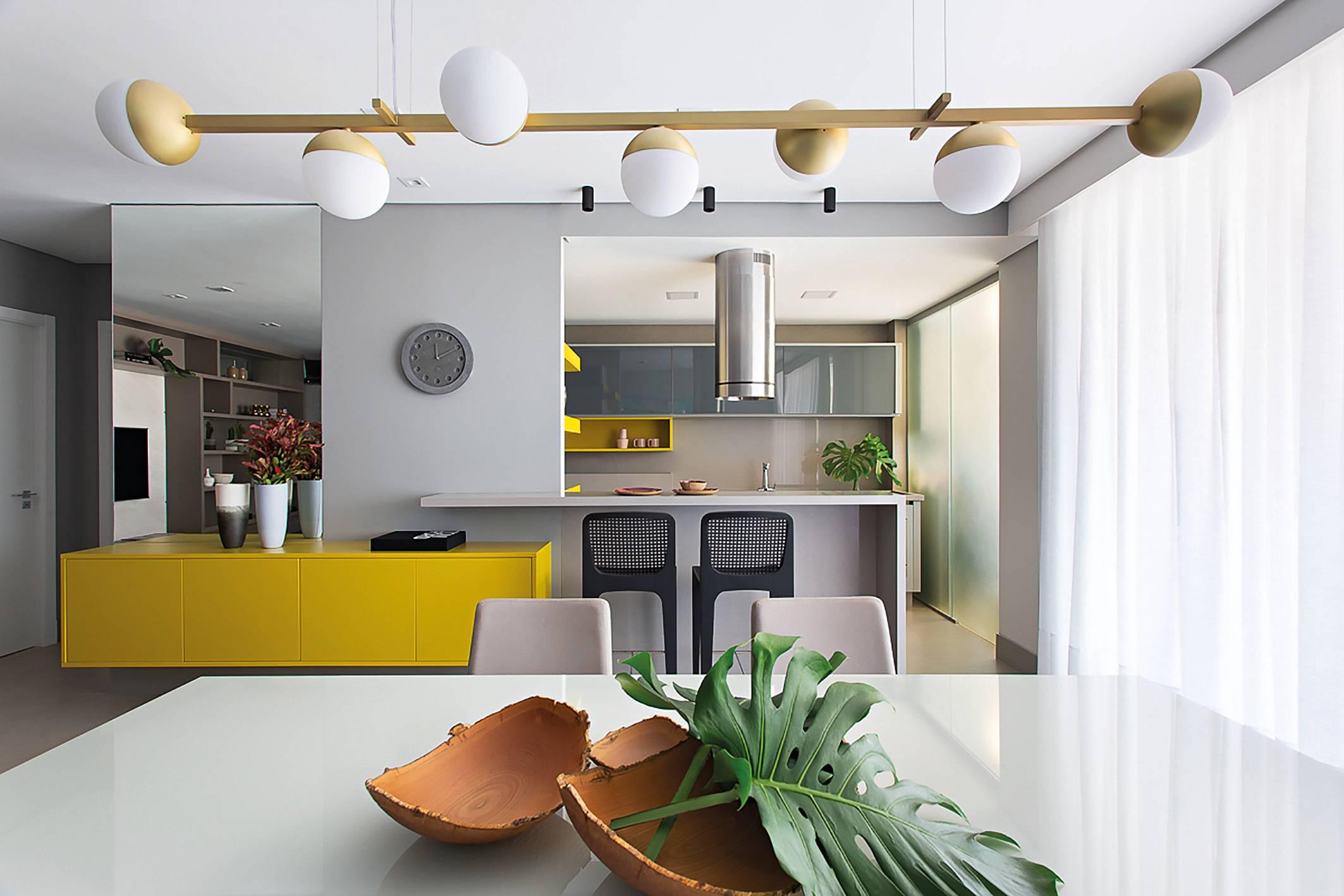 Cozinhas modernas integram diferentes partes da casa em uma só área.
