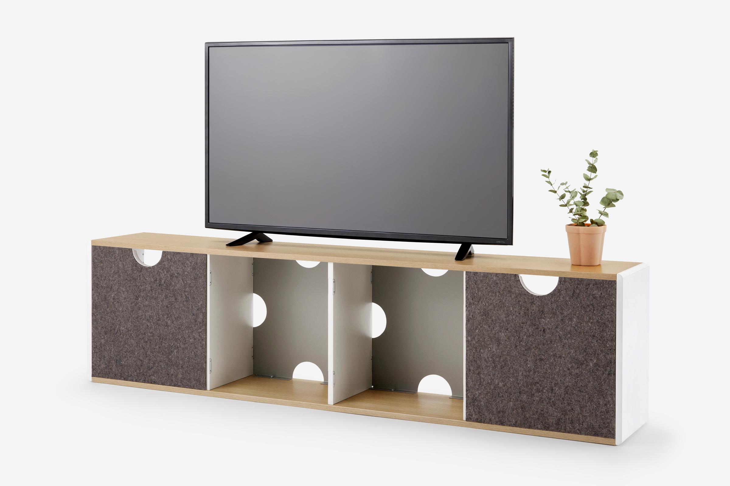 A estante-rack na versão para apoio da tevê: multifuncionalidade. Foto: Abruzzo Studio.