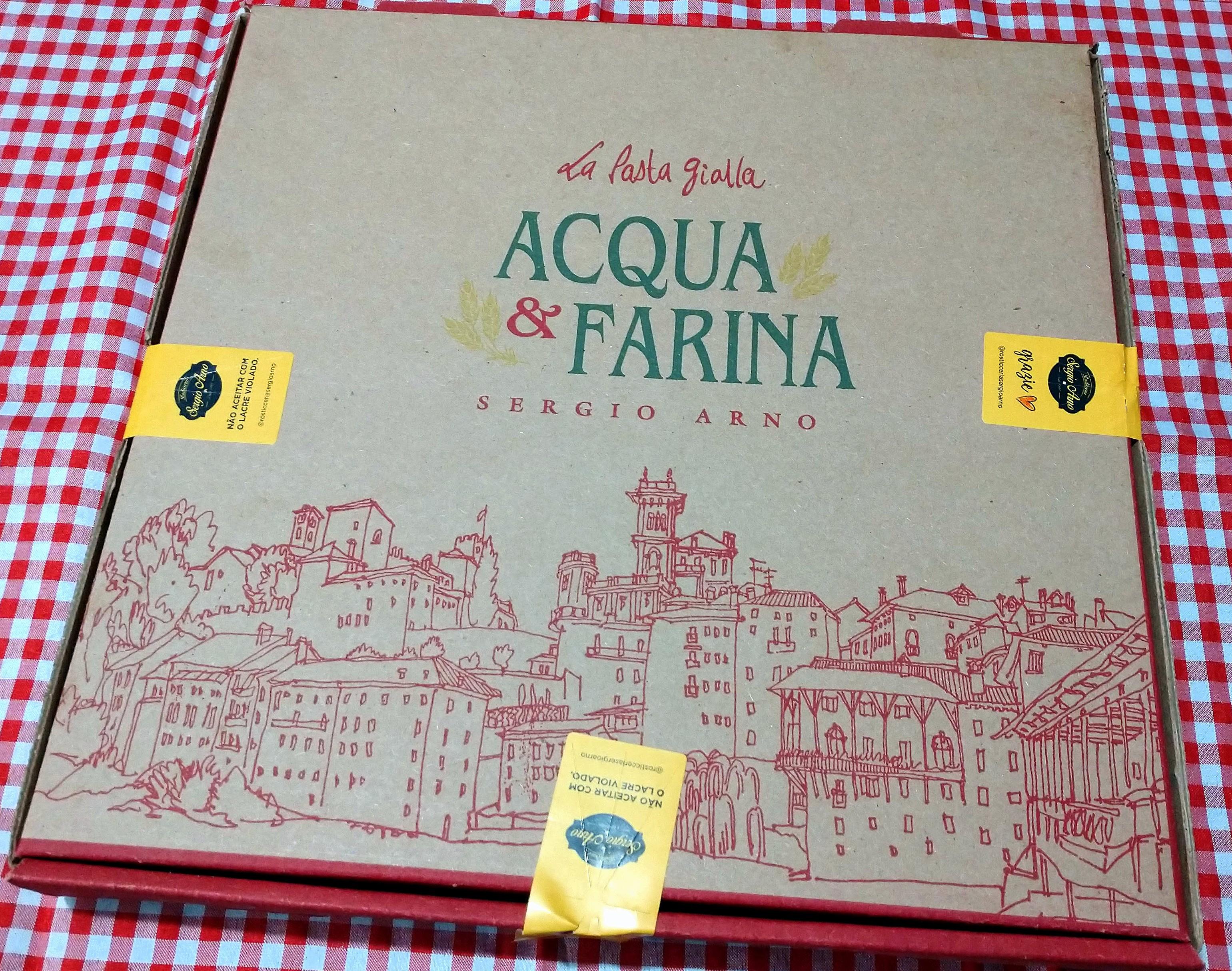 A embalagem do delivery da Pizzaria Acqua & Farina.