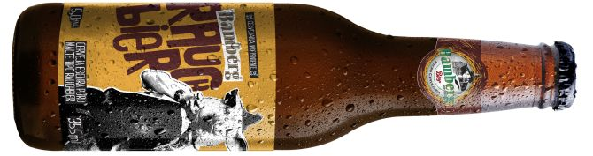 Brown beer bottle, back lighted with drops and condensation, showing a white reflection at right side