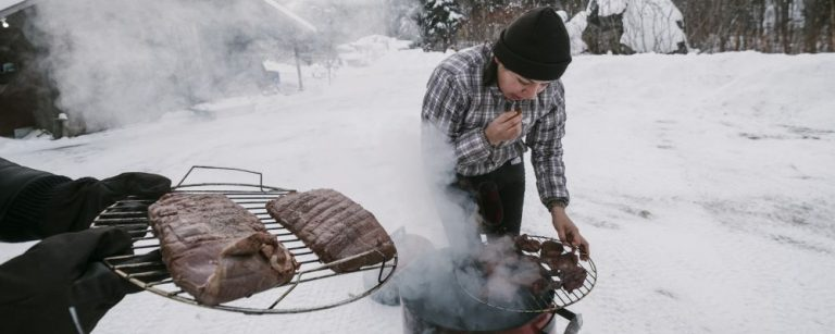 Cezin Nottaway, an Algonquin who runs a catering business, smokes moose meat using a method she learned from her grandmothers in Maniwaki, Quebec, Canada, Dec. 28, 2017. Nottaway is part of a rising generation of indigenous cooks and scholars who are trying to preserve and spread the food culture of their ancestors. (Renaud Philippe/The New York Times)