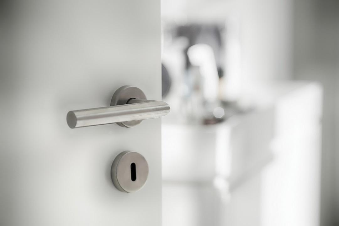Door latch at the bathroom