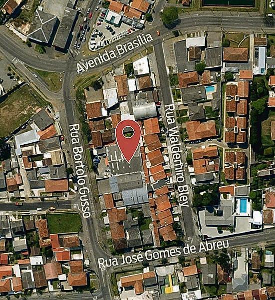 No mapa, a exata localização do centro geográfico de Curitiba, e, abaixo, a fachada da empresa Eletrobit